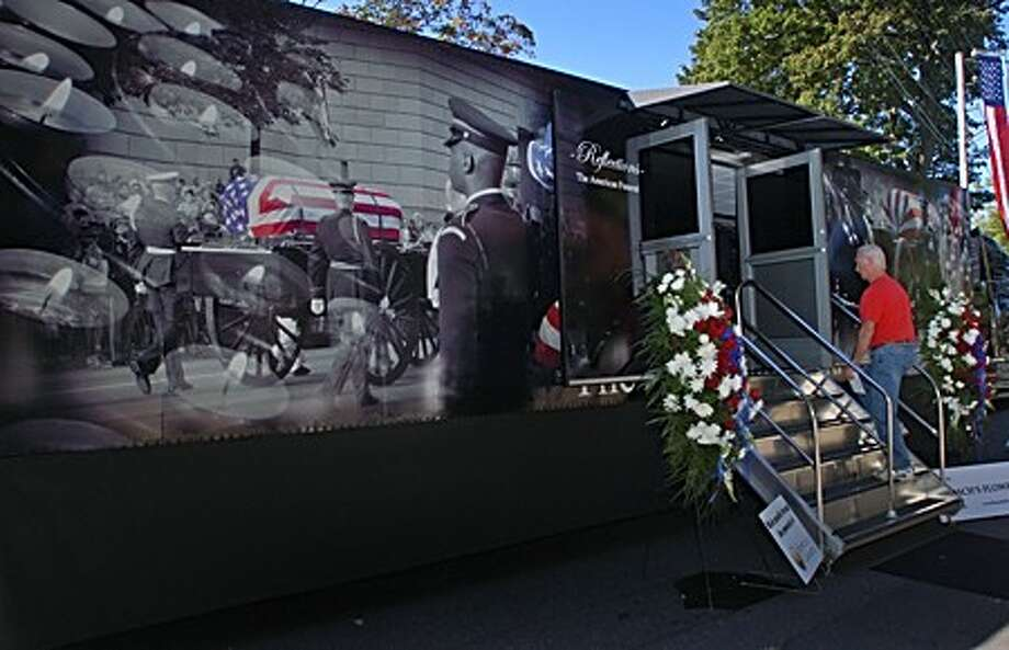 "The traveling historical exhibit, "" Reflections: The American Funeral"" was part of an event sponsored by Hoyt-Cognetta Funeral Home at the Town Green Saturday . Hour photo / Erik Trautmann"