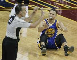 Golden State Warriors' Stephen Curry can't believe a foul called against him in the first quarter during Game 6 of the NBA Finals at The Quicken Loans Arena on Thursday, June 16, 2016 in Cleveland, Ohio.