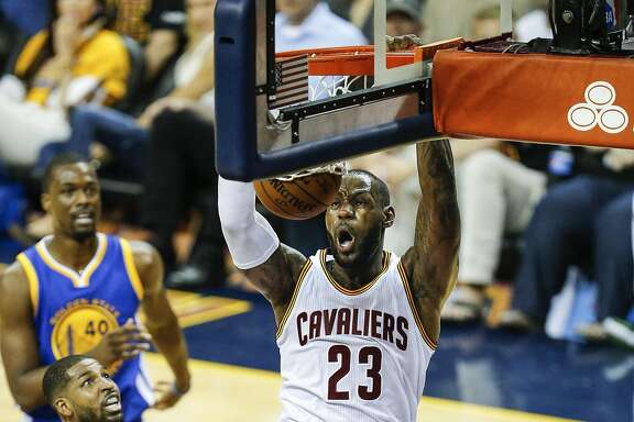 Cleveland Cavaliers' LeBron James dunks in the first quarter during Game 6 of the NBA Finals at The Quicken Loans Arena on Thursday, June 16, 2016 in Cleveland, Ohio.
