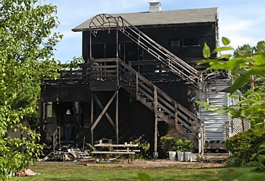 The back of the home on Burwell St. that caught fire early Tuesday morning destroying the rear of the house and killing 2 people. Hour photo / Erik Trautmann