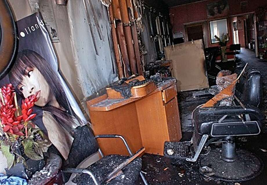 Lila''s Unisex Hair Salon at 14 Belden Ave suffered a devasting fire early Tuesday morning. Hour photo / Erik Trautmann