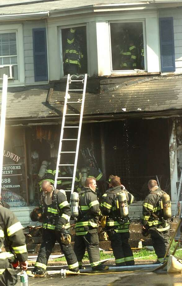 Structure fire burns out retail and residental spaces on 1st street in Norwalk on Monday morning/hour photo matthew vinci