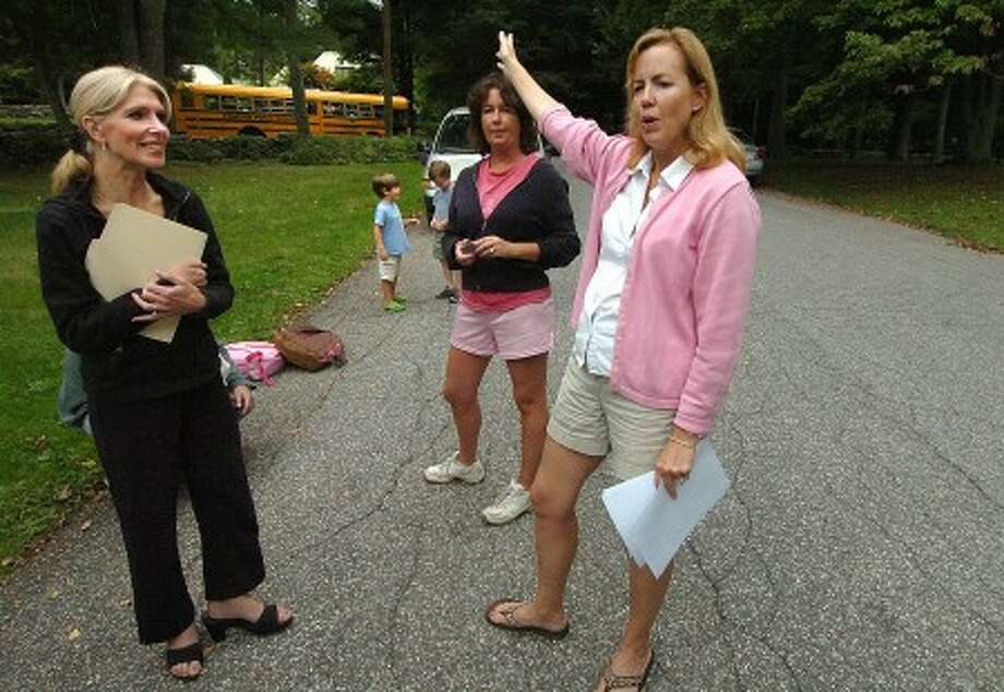 Photo/Alex von Kleydorff. Anne Engel along with other parents meet at the bus stop at the top of Mather Rd. to talk re districting.