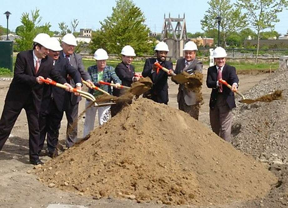 Ground breaking for the Reed Putnam Urban Renewal Project on Wednesady, from left to right, state Rep. Christopher R. Perone, D-137; Norwalk Redevelopment Commission Chairman Paul L. Jones; Mayor Richard A. Moccia; Connecticut Department of Economic and Community Development Commissioner Joan McDonald; state Sen. Bob Duff, D-25; state Rep. Bruce V. Morris, D-140; state Rep. Lawrence F. Cafero Jr., R-142; and Norwalk Redevelopment Agency Executive Director Timothy T. Sheehan, ... /hour photo matthew vinci