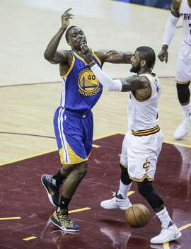 Cleveland Cavaliers' Kyrie Irving knocks the ball away from Golden State Warriors' Harrison Barnes in the first quarter during Game 6 of the NBA Finals at The Quicken Loans Arena on Thursday, June 16, 2016 in Cleveland, Ohio.