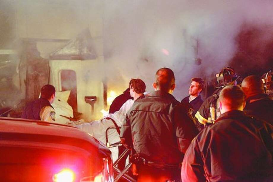 Historical Society curator and family survive house explosion