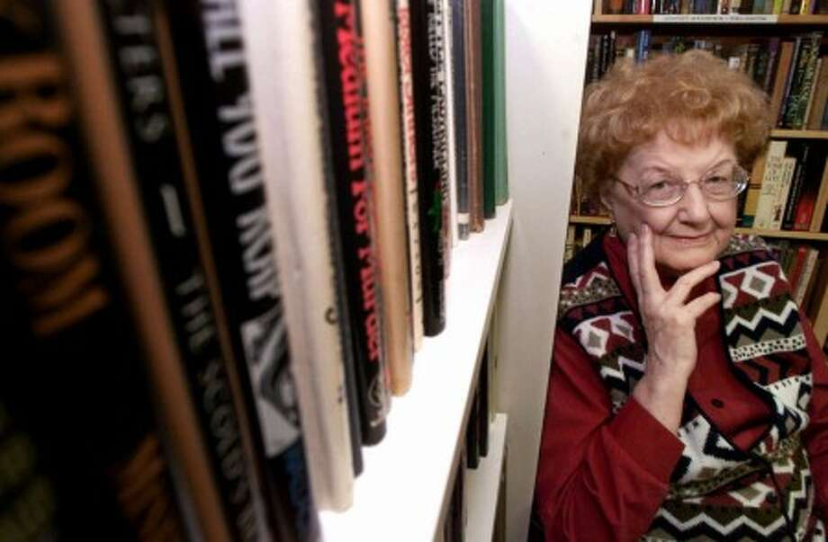 In this Nov. 30, 1999 file photo shows science fiction and fantasy author Andre Norton, 87, among the books of the High Hallack Genre Writer''s Research and Reference Library in Murfreesboro, Tenn., which she established. (AP Photo/Mark Humphrey,File)