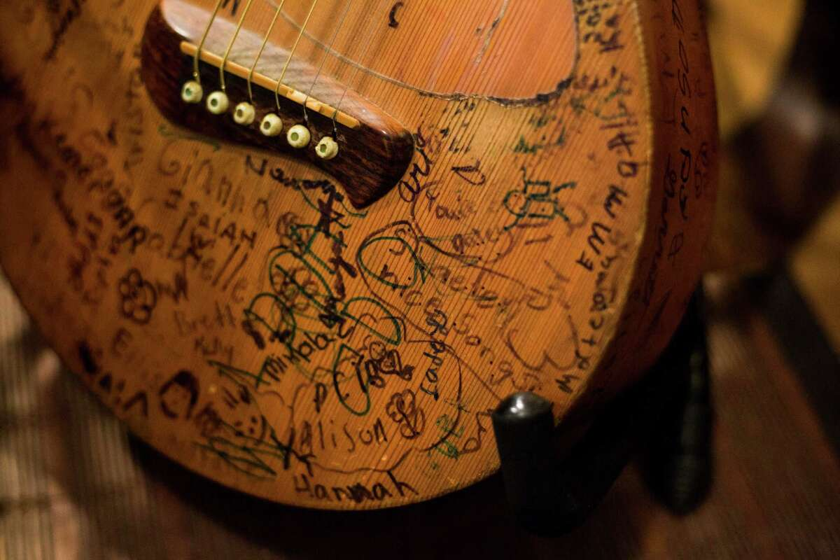 """A guitar signed by children sits in the San Marcos home of Terri Hendrix. Hendrix is set to release """"Slaughterhouse Sessions,"""" the second of a five-album project."""
