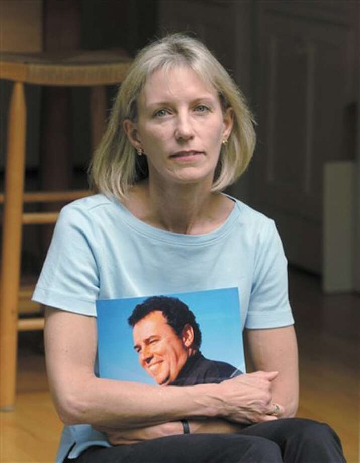 *** FILE *** In this Friday, May 24, 2002 file photo, Beverly Eckert, 50, of Stamford, Conn., holds a picture of her late husband Sean Rooney, 50, in Stamford, Ct. Eckert, one of the victims of Continental Flight 3407, was a Sept. 11 widow who lost her her husband Sean Rooney, her high school sweetheart, in the World Trade Center. (AP Photo/Douglas Healey, File)