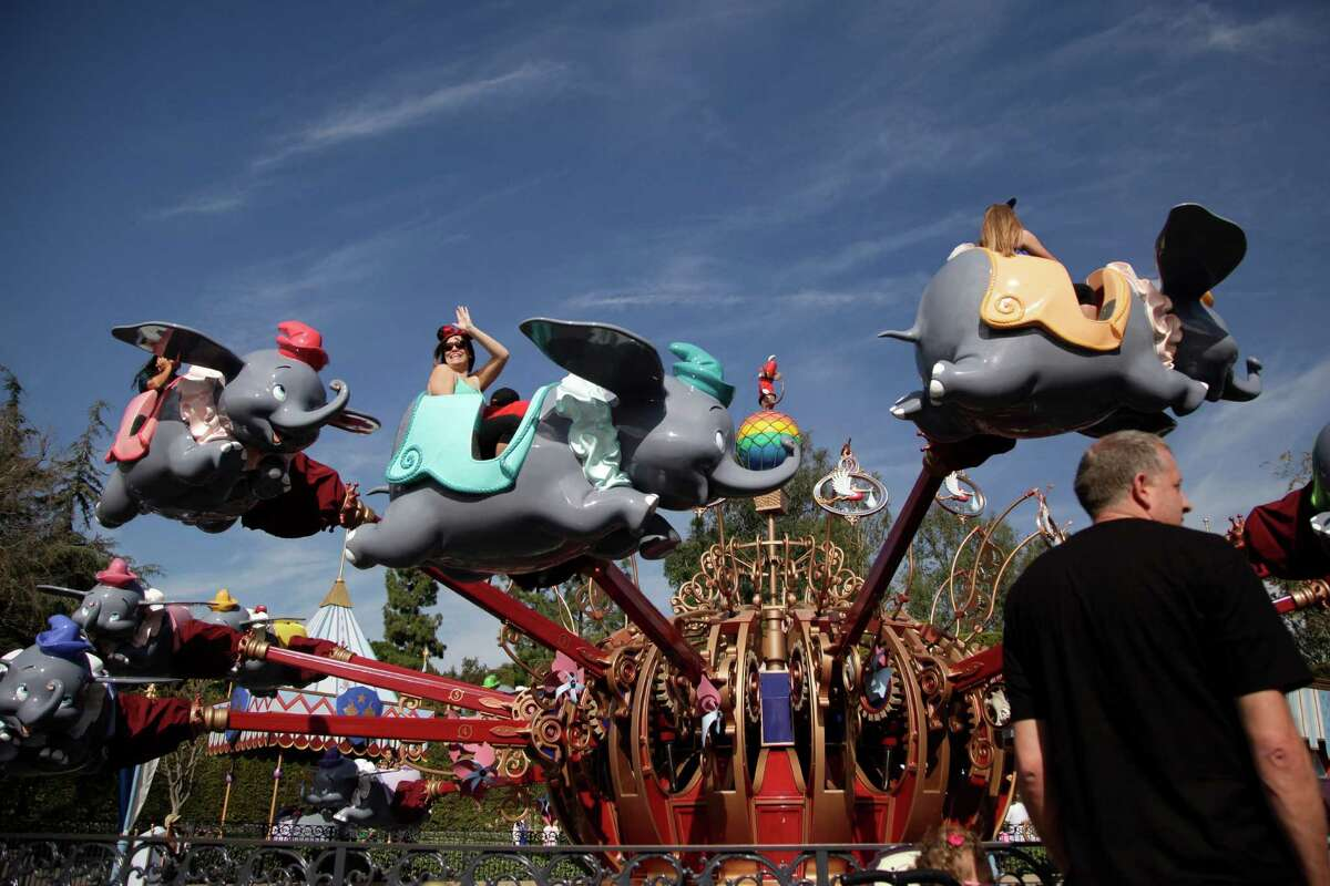 FILE - In this Jan. 22, 2015, file photo, visitors ride the Dumbo the Flying Elephant ride at Disneyland in Anaheim.