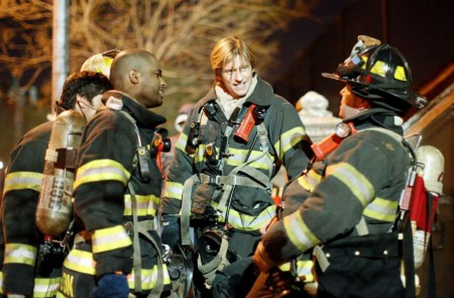 "Actor Dennis Leary, center, takes a break with other cast members during filming for an upcoming episode of the television show ""Rescue Me"" Thursday, Jan. 29, 2009 in New York. ""Rescue Me"" returns for its fifth season Tuesday at 10 p.m. EDT, kicking off an extra-long run of 22 episodes. (AP Photo/Jason DeCrow)"