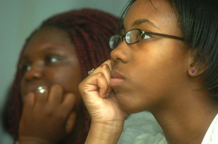 Photo/Alex von Kleydorff. l-r 11th graders Shamajah Addison and Nakitta Fuller watch president Obama''s education speech during a special class set up for the broadcast at Briggs High School.
