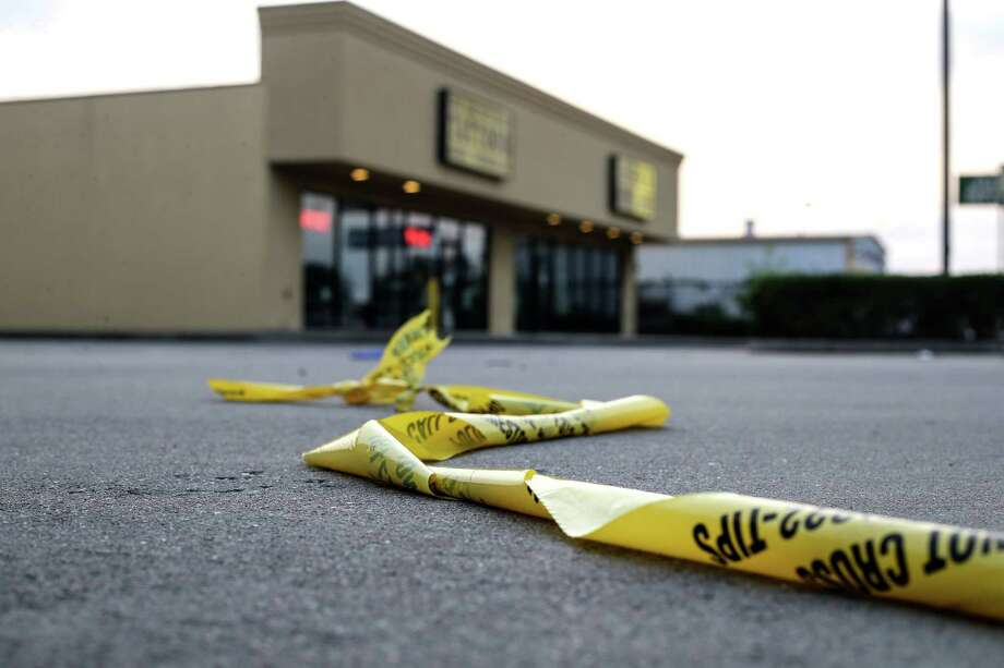 Police tape remains outside a strip mall. Photo: Elizabeth Conley, Staff / © 2016 Houston Chronicle