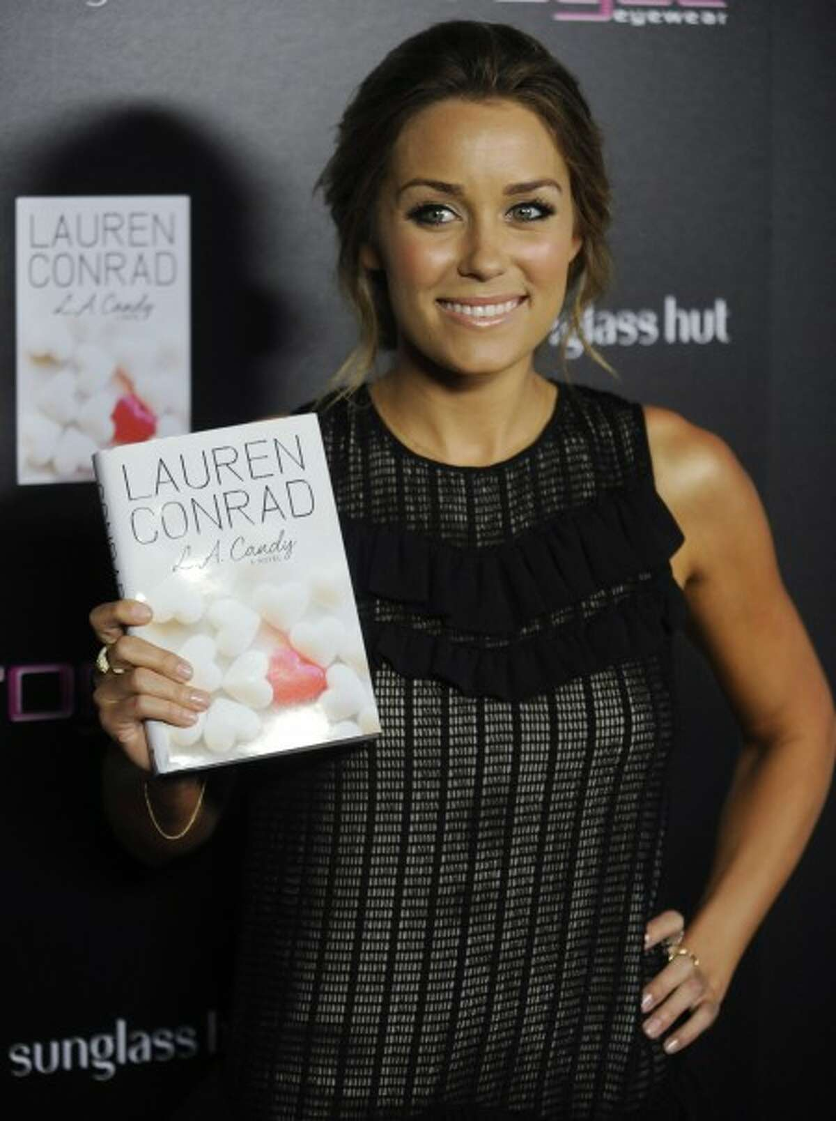 """Lauren Conrad arrives at the launch of her new novel """"L.A. Candy"""" June 10 in Beverly Hills, Calif. (AP Photo/Chris Pizzello, file)"""