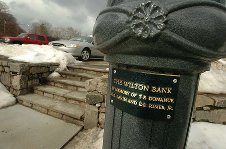 Photo/Alex von Kleydorff. Lamp post in Wilton center with memorial plaque, sponsored by The Wilton Bank