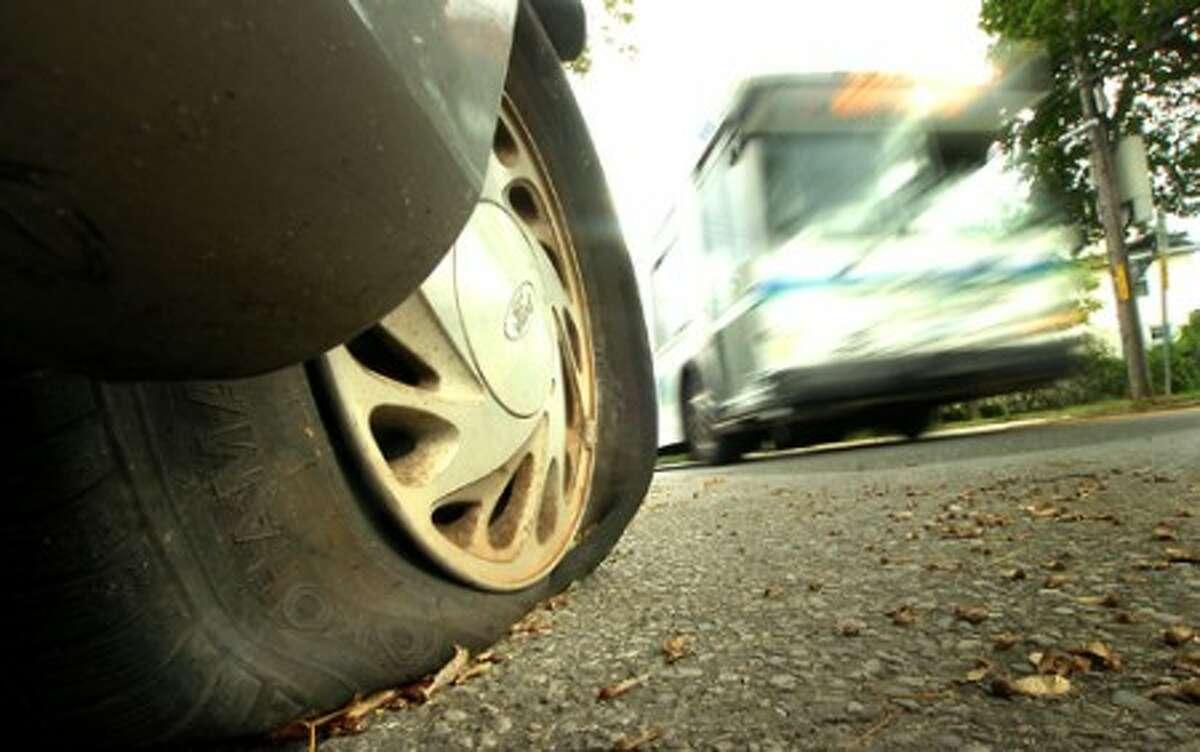Photo/Alex von Kleydorff. Slashed tires on a Minivan on Ward Street Norwalk.