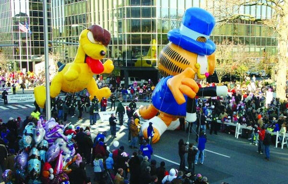 Photo/Alex von Kleydorff. Garfield and Odie make their way down Summer st in the UBS parade spectacular.