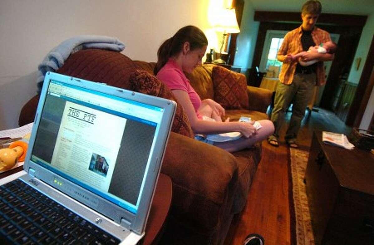 Photo/Alex von Kleydorff. Kristen Gilligan and husband Len Vlahos with one month old Charlie, part of the baby blogging community.