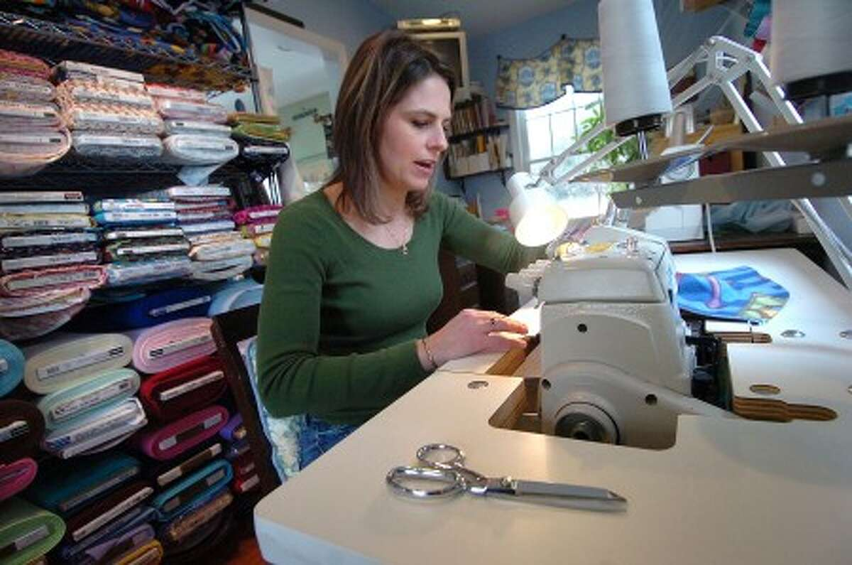 Photo/Alex von Kleydorff. Jill Chuckas, Owner, Designer of www.craftbaby.com works on sewing the pillow portion of a Nap Pack fleece all in one nap mat for kids in her Stamford design studio.