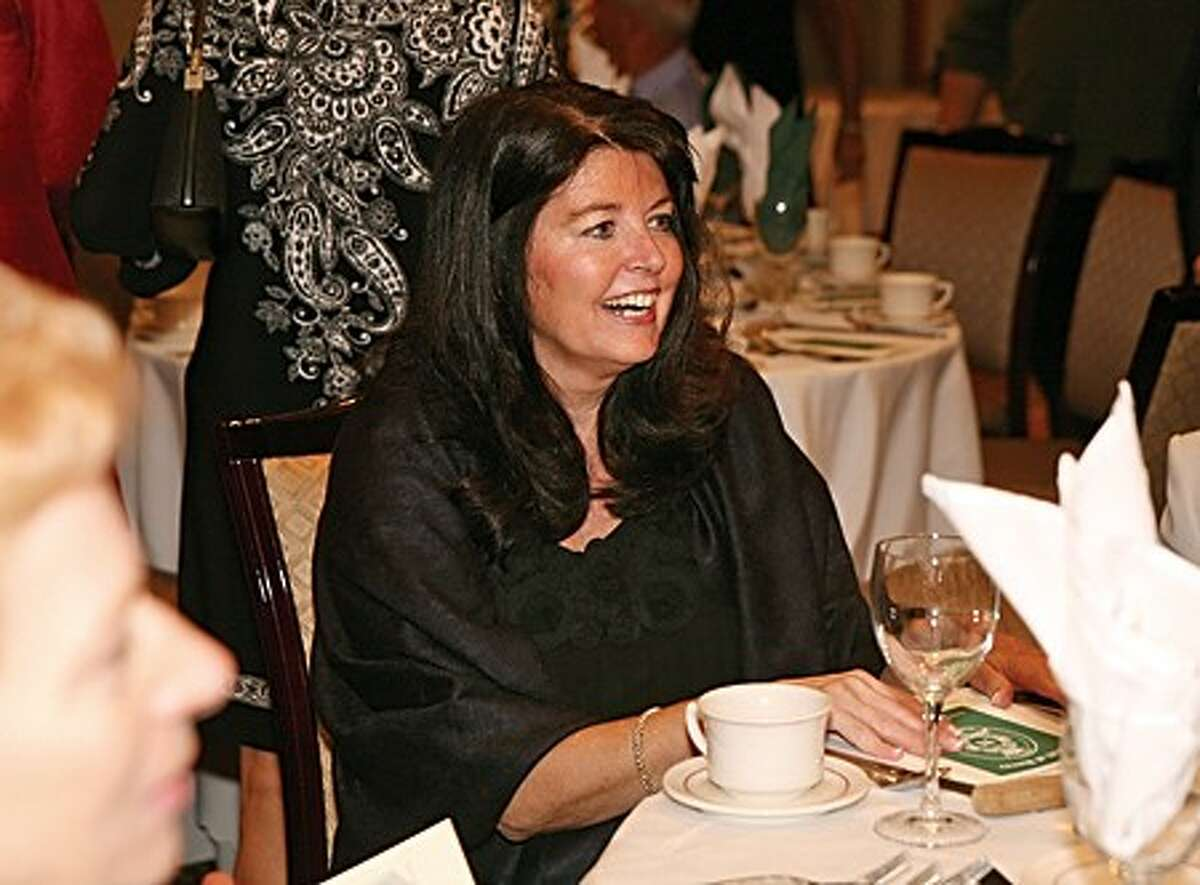 Beverly Lambert of the Norwalk High School Class of 1969 enjoys the 15th annual Norwalk High School Wall of Honor dinner in which she was awarded with an installment Sunday at the Norwalk Inn. Hour Photo / Danielle Robinson