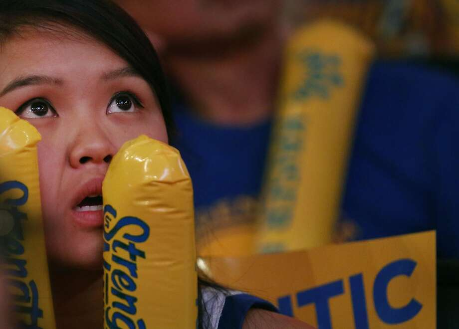 A fan reacts during the end of the first half while watching Game 6 of the NBA Finals between the Warriors and the Cavaliers during the Warriors Official Watch Party June 16, 2016 in the Oracle Arena Oakland, Calif. Photo: Leah Millis, The Chronicle
