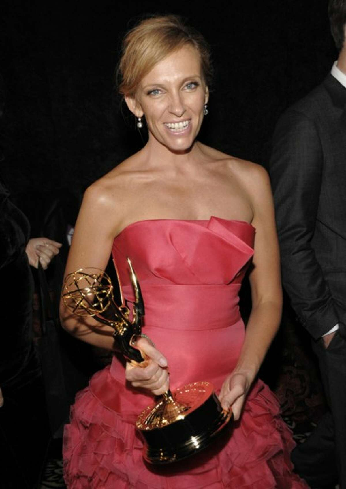 Actress Toni Collette arrives at the HBO Emmy Party in West Hollywood, Calif. on Sunday, Sept. 20. Collette won an Emmy earlier in the evening for best actress in a comedy series. (AP Photo/Dan Steinberg)