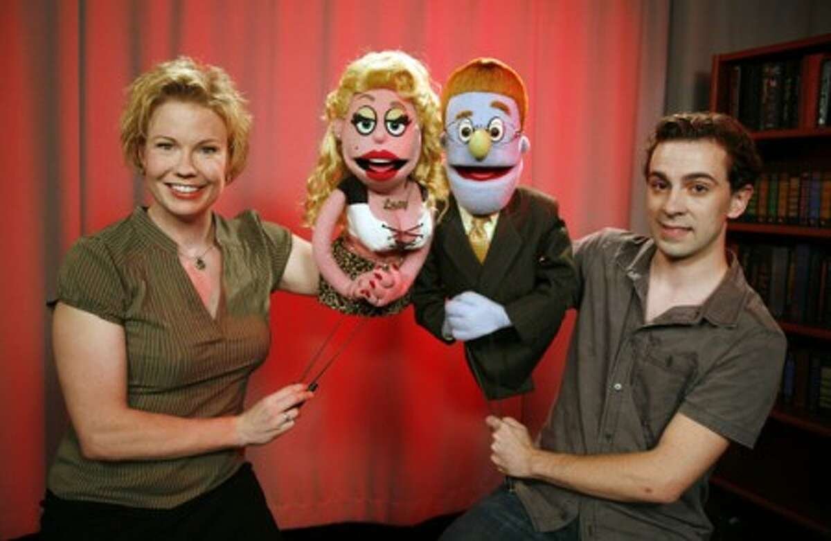 """Performers in the Broadway company of """"Avenue Q,"""" Jennifer Barnhart with Lucy the Slut, left, and Robert McClure with Rod, are shown Monday, Aug. 17, 2009 in New York. The production, at the Golden Theatre in New York, will close on Sept. 13. (AP Photo/Jeff Christensen)"""