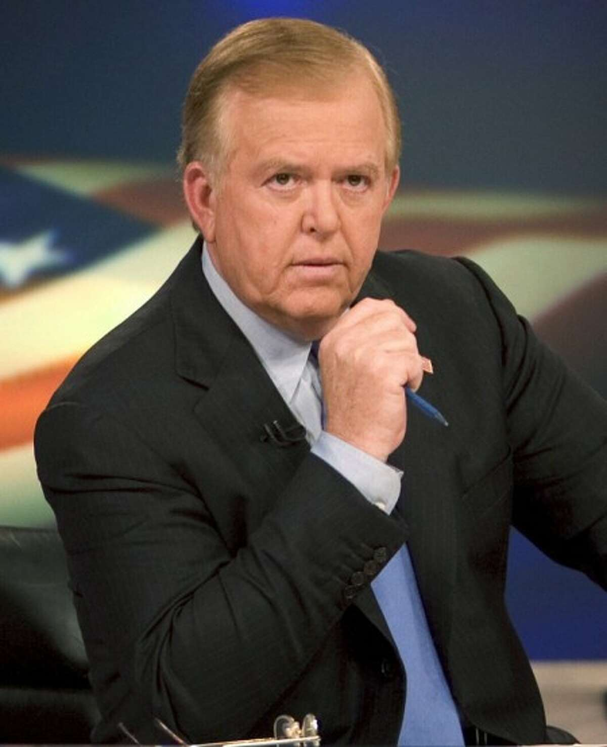 """FILE - In this 2005 file photo provided by CNN, news anchor Lou Dobbs sits on the set of his show, """"Lou Dobs Tonight,"""" in New York (AP Photo/CNN, Mark Hill, File)"""