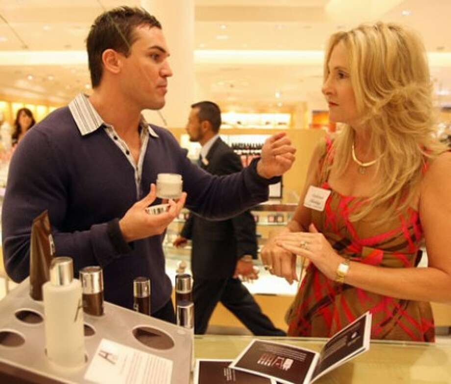 Barry Alford pitches his line of new men''s luxury grooming products to Deborah Harding at Neiman Marcus in Orlando.(MCT)