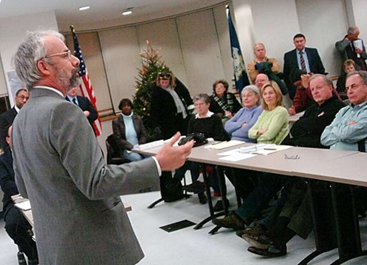 J.F. Ryan revaluation manager with J.F. Ryan Associates Inc. speaks to residents addressing the preliminary revaluation results for South Norwalk, Golden Hill, Spring Hill, Shorefront Park and the Harborview area on Tuesday night/hour photo matthew vinci