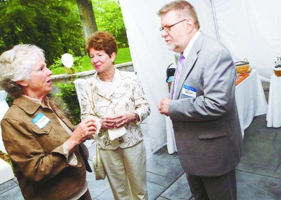 Guest Julie Forrester, Mary Jane Darrow, Marketing Associate with the Greens at Canondale and Andy Krochko Administrator for Wilton Meadows Rehabilitation Center at the grand opening of the Greens At Cannondale assited living on Tuesday/photo matthew vinci