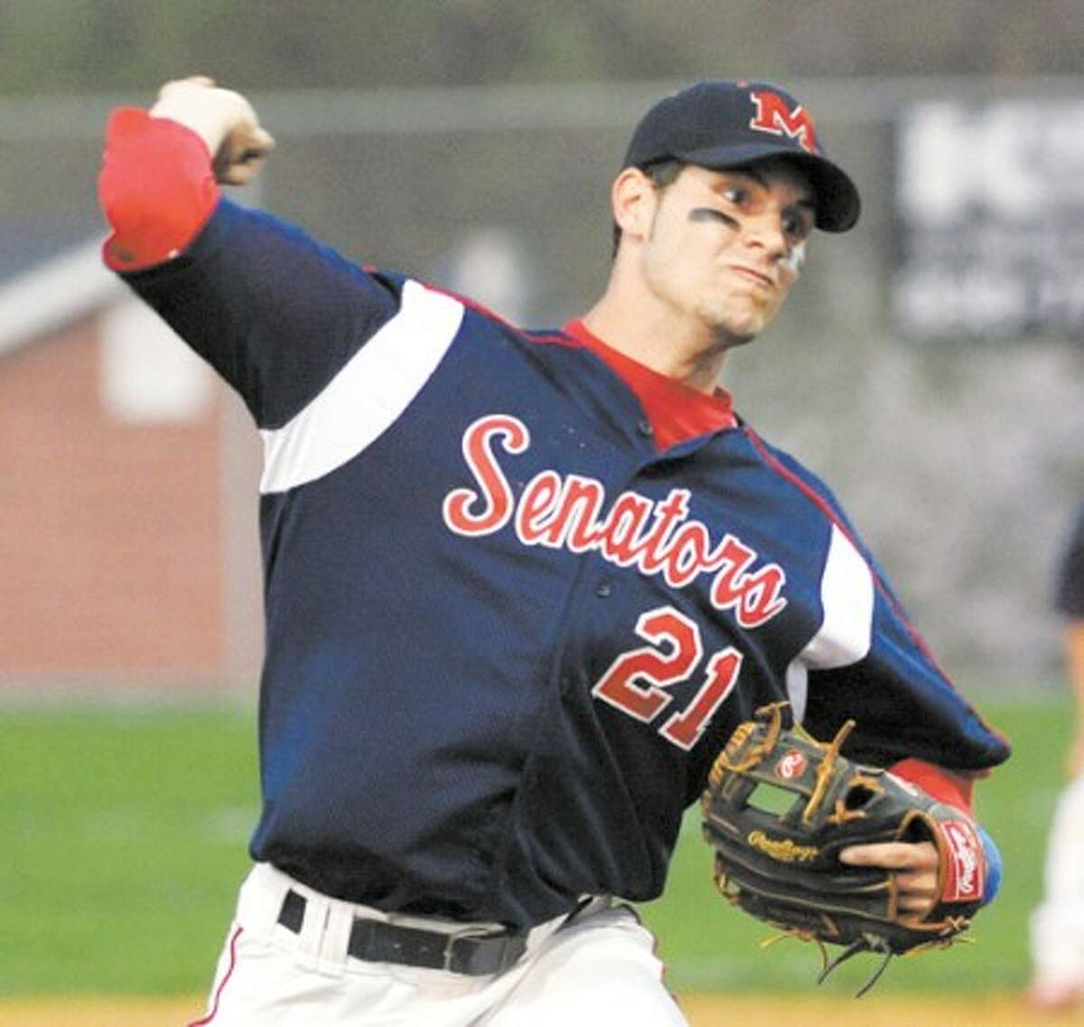Hour Photo/John Nash - Brien McMahon pitcher Eric Stenger fires to the plate during Thursday night''s game against Norwalk.