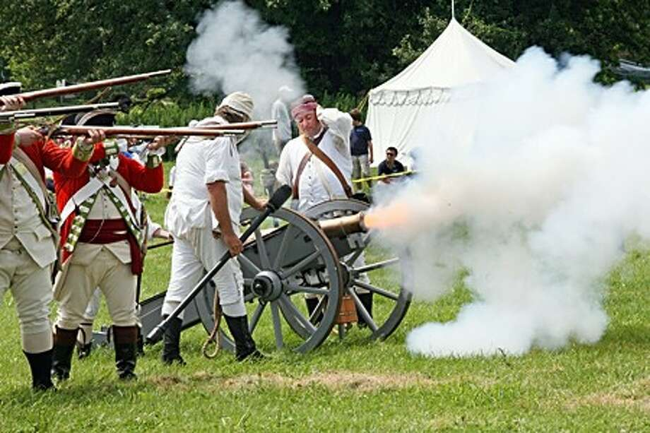A canon is fired during The Reenactment of the Battle of Norwalk at Taylor Farm in Norwalk Saturday afternoon. The battle, open free to the public, was put on by Celebrate The Past, Inc. and Sheldon''s Horse, 2nd Light Continental Dragoons. Hour Photo / Danielle Robinson