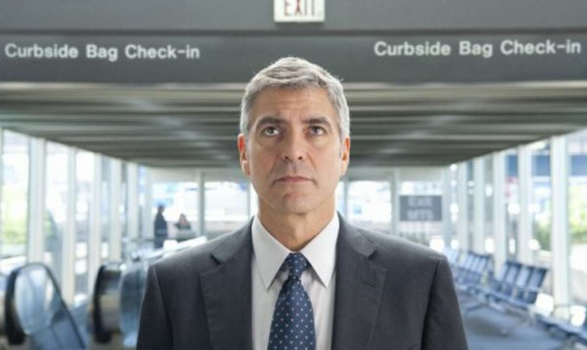 """George Clooney portrays Ryan Bingham in a scene from """"Up in the Air."""" The film was nominated for a Golden Globe award for best motion picture drama, Tuesday, Dec. 15. (AP Photo/Paramount Pictures, Dale Robinette)"""