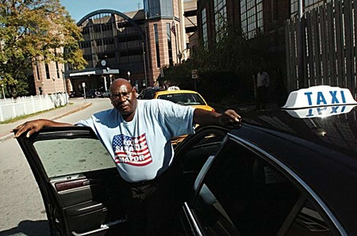 """Norwalk cabbie Preston """"Shorty"""" McClain in front of the New York bound side of the South Norwalk train station. Cabbies are upset they had to move into designated parking spaces on the this side of the station and are backing Mayoral candidate Steven A. Serasis/hour photo matthew vinci"""
