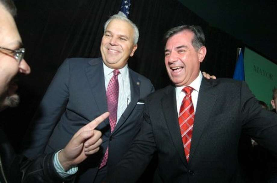 Photo/Alex von Kleydorff. Lt. Governor Michael Fedele joins Stamford mayor elect Michael Pavia on the podium as he accepts victory as mayor of Stamford.