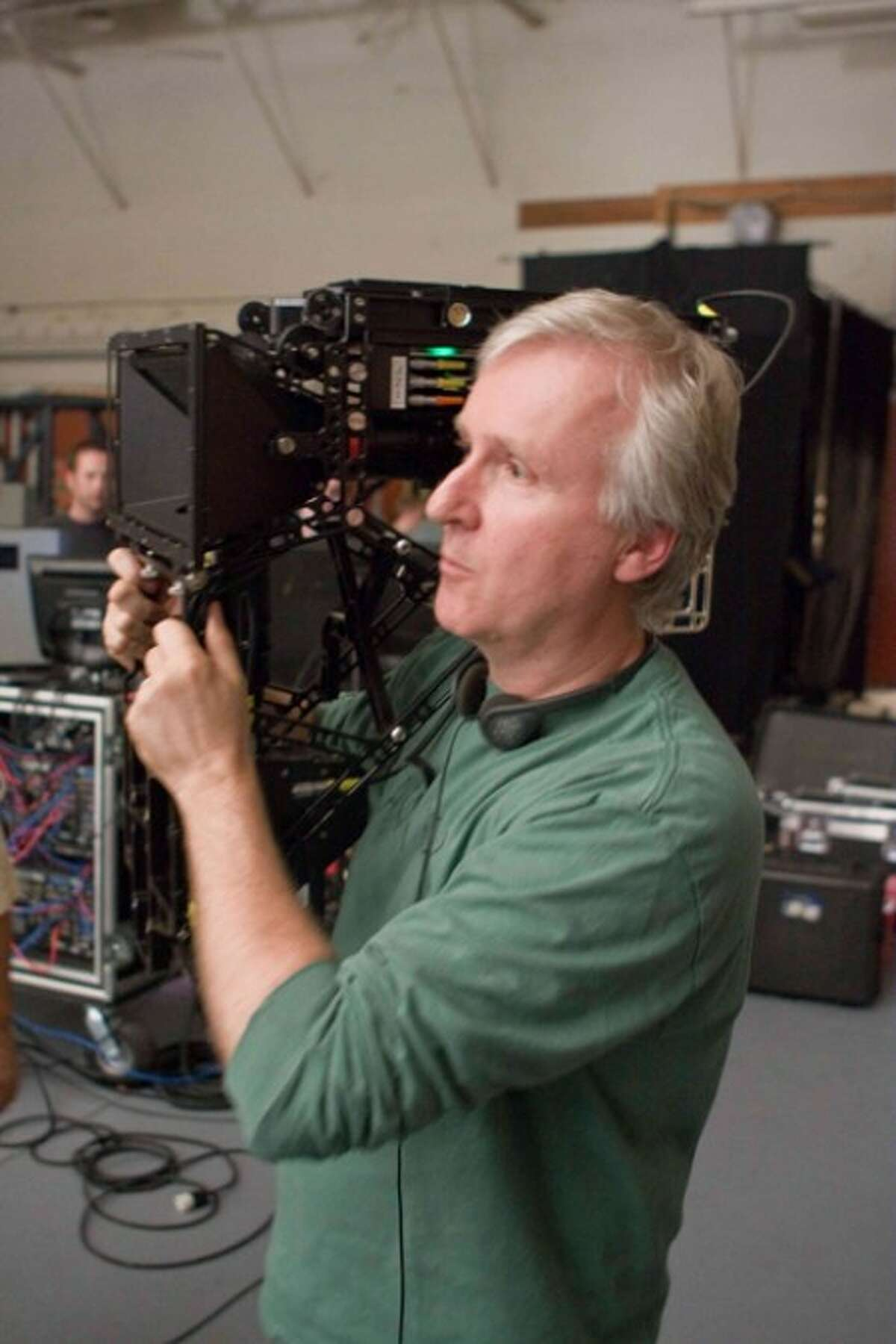 """In this undated photo released in Tokyo, Japan, by Twentieth Century Fox Film Corp., film director James Cameron is at work for 3-D sci-fi adventure """"Avatar."""" Japanese electronics maker Panasonic Corp. has signed on """"Titanic"""" director Cameron and his upcoming film """"Avatar"""" in an advertising blitz for its TVs equipped with 3-D technology, both sides said Friday, Aug. 21, 2009. The film is scheduled to be released at movie theaters in Japan on Friday, Dec. 18, 2009 by Twentieth Century Fox. (AP Photo/Twentieth Century Fox Film Corp.) **NO SALES, CREDIT MANDATORY, EDITORIAL USE ONLY**"""
