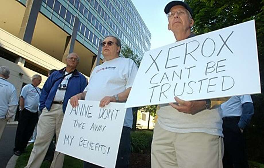 Joe Hruschak and Joel Jameson picket outside Xerox Headquarters on Glover Ave about benefit cuts the company recently imposed. Over 50 employees from the Rocherster NY site trveled by bus overnight to protest the cuts. Hour photo / Erik Trautmann