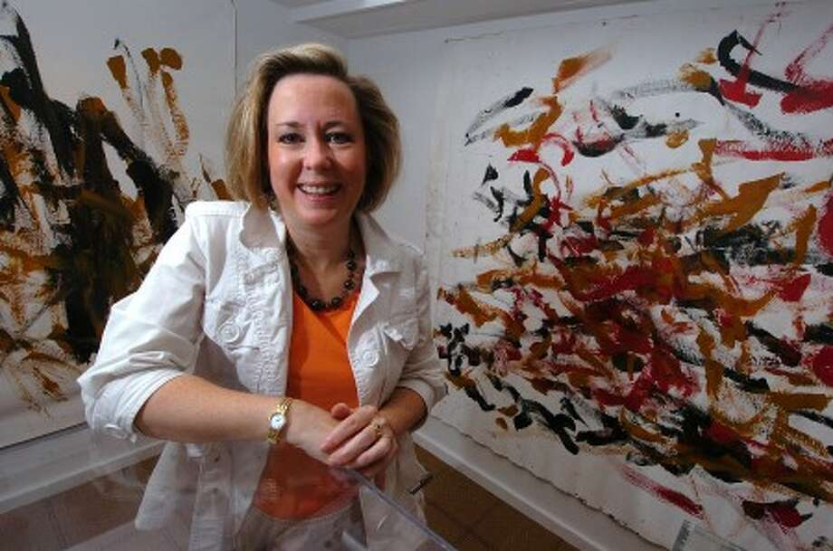Photo/Alex von Kleydorff. Liz Ball in her Pierce Ball Gallery with some of the larger artwork created by Thembi, an African elephant.