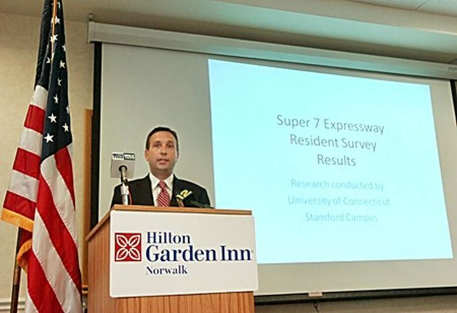 State Senator Bob Duff (D-25) holds a press conference announcing the results of the UConn Stamford survey on support for the Super 7 Expressway at the Hilton Garden Inn Wednesday. Hour photo / Erik Trautmann