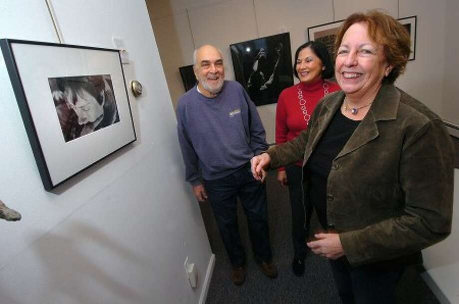 Photo/Alex von Kleydorff. L-R. Photgrapher and Norwalk resident Irwin Block gets help hanging is Photograph titled ''Sally'' for Faces and Figures show from gallery manager Marguerite Weinert and Stamford Art Assocition co president Christine Irvin at the associations gallery on Franklin St