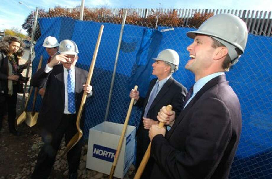 Photo/Alex von Kleydorff. L-R Norwalk Trainsit District Administrator Lou Schulman, Andy Glickson, Commissioner, Norwalk Transit District and Congressman Jim Himes put on hard hats during a groundbreaking ceeremony with others at the Wheels Hub on Burnell Blvd.