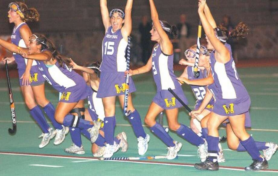 Photo by John Nash - Westhill celebrates one of its goals in Tuesday''s city championship win over Stamford.