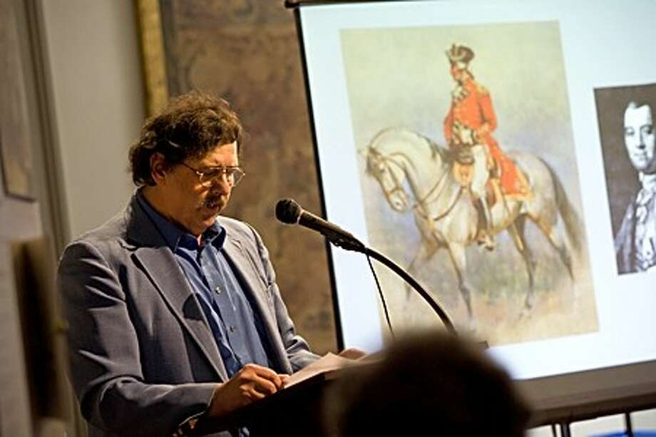 "Ed Eckert, Board Member of the Norwalk Historical Society, gives a lecture called ""The Battle and Burning of Norwalk"" inside the Town House Museum at Mill Hill Historic Park Sunday afternoon. Hour Photo / Danielle Robinson"