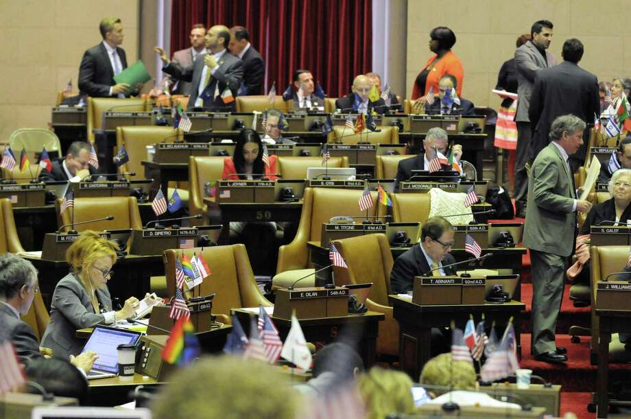 Assemblymembers and staff work on the final scheduled day of session for lawmakers at the Capitol on Thursday June 16, 2016 in Albany, N.Y. (Michael P. Farrell/Times Union) Photo: Michael P. Farrell / 40037008A