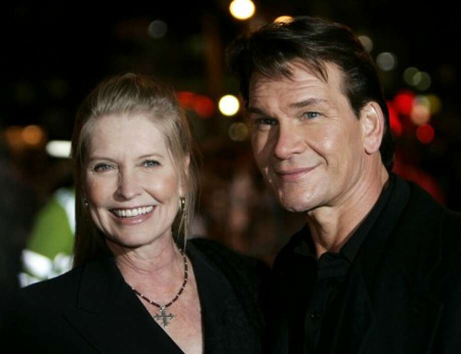 """In this Nov. 28, 2005 file photo, actor Patrick Swayze, right, accompanied by his wife Lisa Niemi pose prior to the premiere of his film """"Keeping Mum"""" in central London. Swayze''s publicist Annett Wolf says the 57-year-old """"Dirty Dancing"""" actor died Monday, Sept. 14, 2009, after a nearly two-year battle with pancreatic cancer. (AP Photo/Lefteris Pitarakis, file)"""