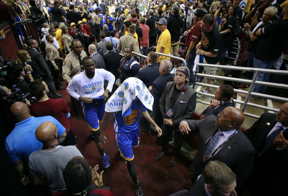 Warriors' Draymond Green and Shaun Livingston make their way to the locker room after the defeat as the Golden State Warriors lost  115-101 to the Cleveland Cavaliers in game 6 at Quicken Loans Arena in Cleveland, Ohio on Thurs. June 16, 2016. The series is now tied 3-3. Photo: Michael Macor, The Chronicle