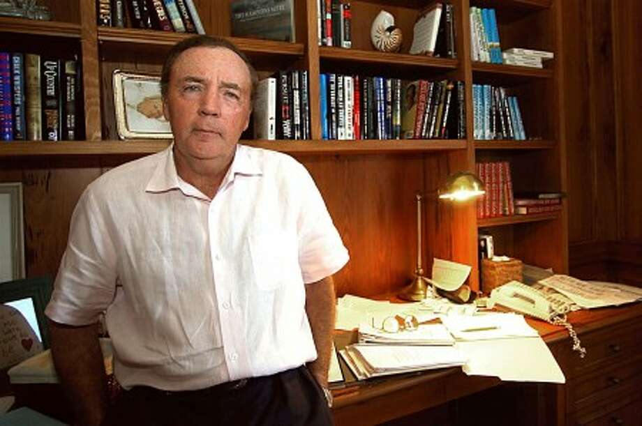 "This Feb. 28, 2003 file photo shows author James Patterson, of Palm Beach Fla, posing in his study. Patterson''s latest best-seller, ""The Angel Experiment,"" is a little different from his usual hits. The novel isn''t new; it came out four years ago. Its sales aren''t happening at bookstores, but mostly on the Kindle store at Amazon.com. And the price is low even for an old release: $0.00 (AP Photo)"
