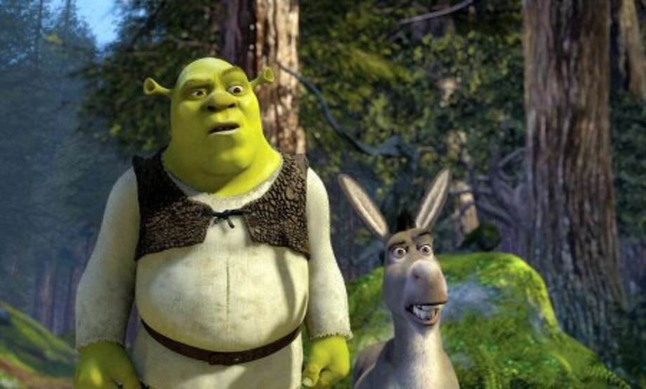 "In this 2004 film publicity image released by DreamWorks Pictures, Shrek, voiced by Mike Myers, left, and Donkey, voiced by Eddie Murphy are shown in a scene from ""Shrek 2."" (AP Photo/DreamWorks Pictures, file)"