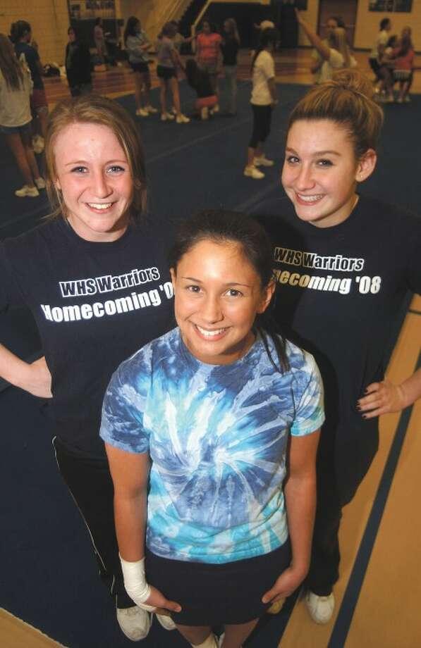 Photo by John Nash - Wilton cheerleading captains, from left to right, Amanda Sirois, Theresa Marino and Amanda Jenks.